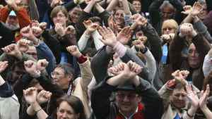 Protesters symbolically raise and cross their arms as prisoners, during a demonstration in Marseille, southern France, Wednesday, April 8, 2009. Humanitarian associations demonstrated in front of court houses in major cities around France to protest the rules that put pressure on those who assist illegal immigrants in any way.