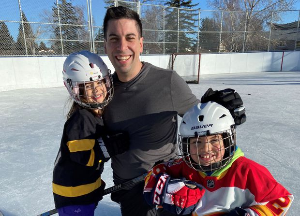 Chris Snow at his neighbourhood rink in Calgary with his son Cohen and daughter Willa.