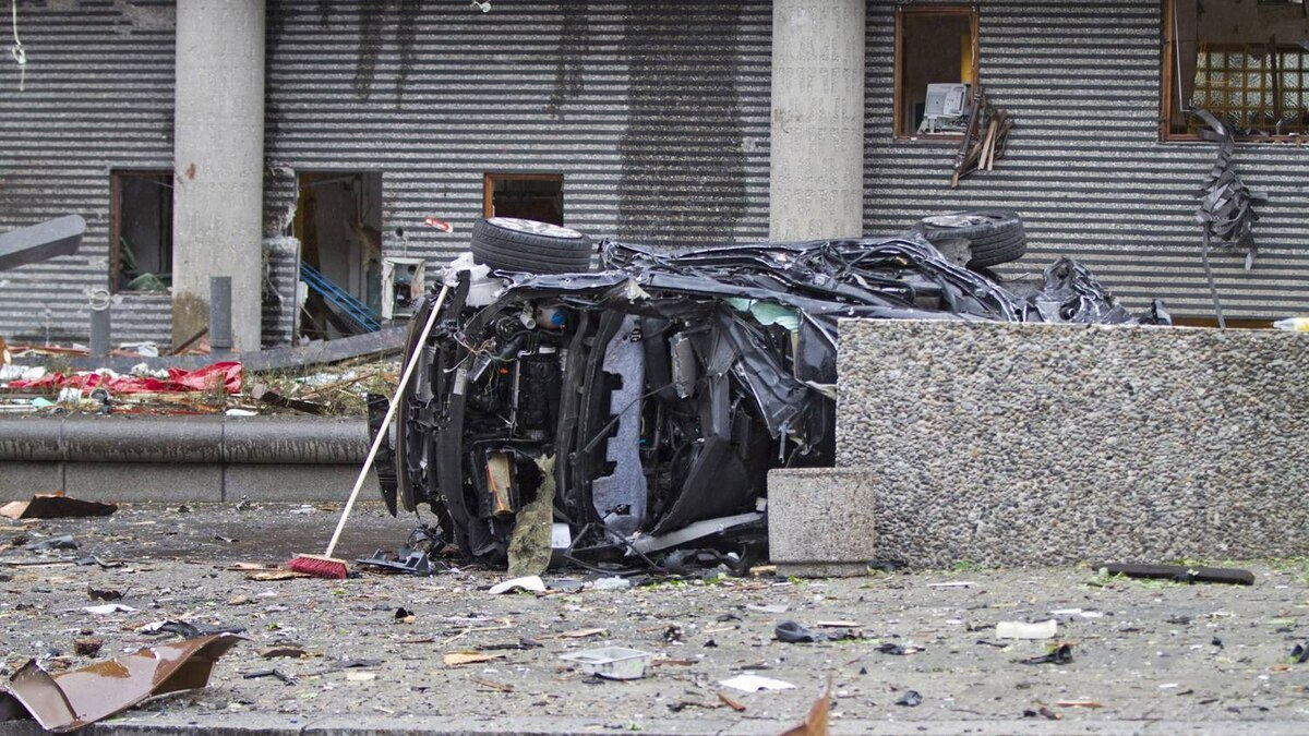 The wreckagew of a car lies outside a building in the centre of Oslo, Friday July 22, 2010, following an explosion that tore open several buildings.