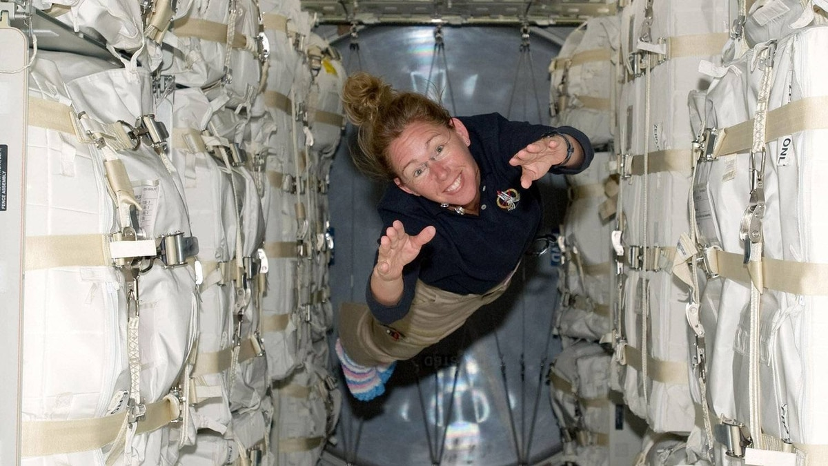 NASA astronaut Sandy Magnus, STS-135 mission specialist floats about the Raffaello multi-purpose logistics module aboard space shuttle Atlantis as its docked to the International Space Station July 11, 2011 in space.