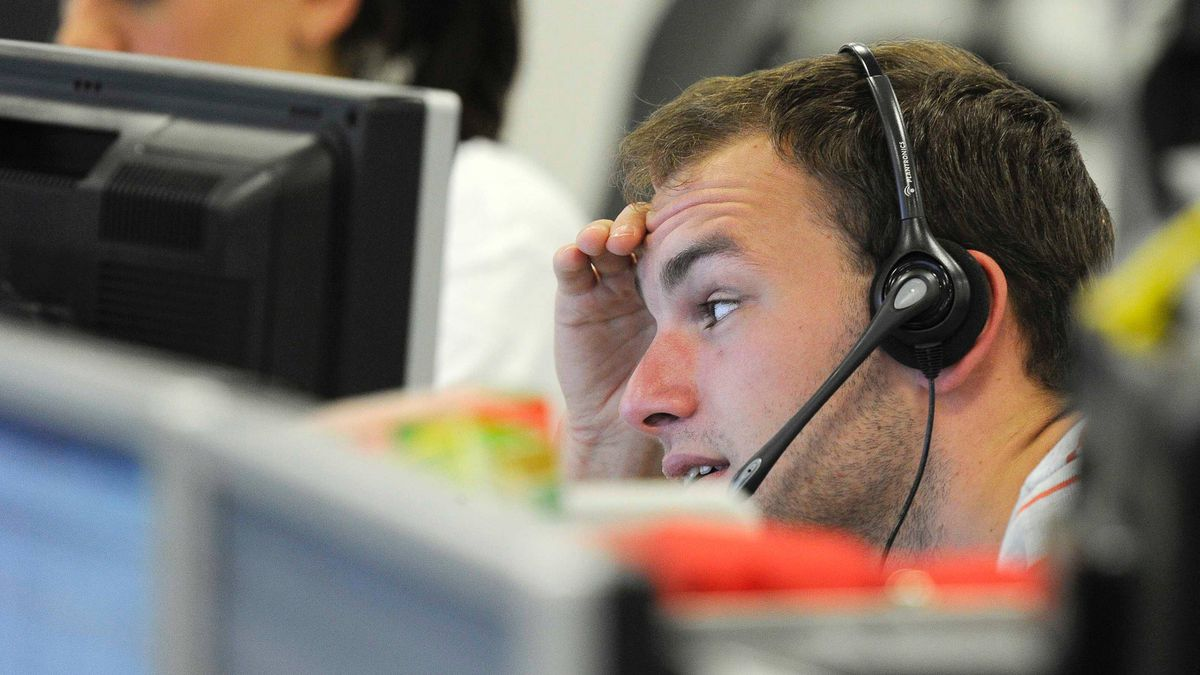 A trader checks screen data at the IG Index trading floor in London June 11, 2011.
