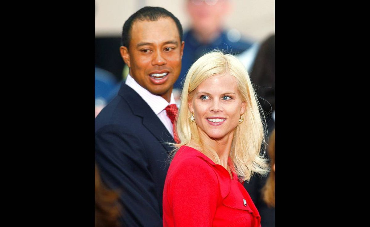 Tiger Woods with his wife Elin Nordegren at the Presidents Cup golf tournament in San Francisco, California, in this Oct. 7, 2009 file photo.
