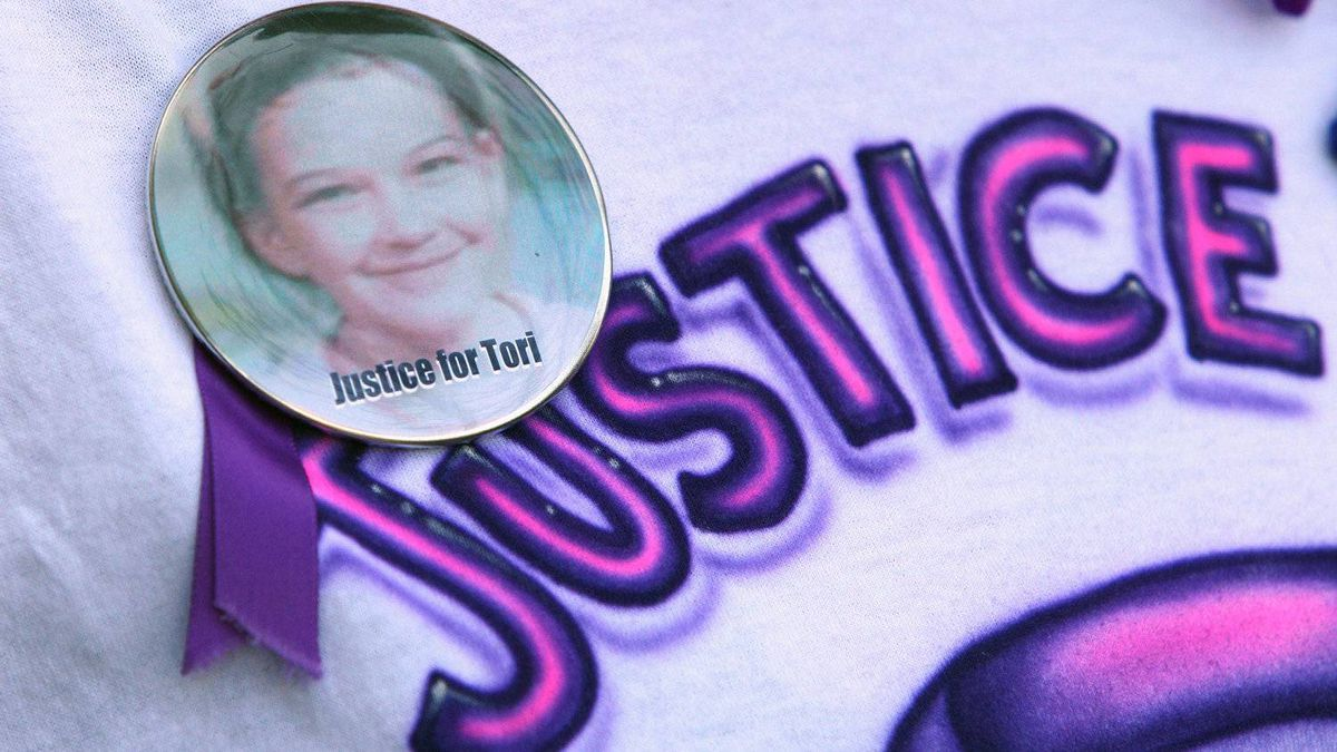 "Patrina Fraser, girlfriend of Rodney Stafford, wears a t-shirt and button with the message ""Justice for Tori"", outside the courthouse at the Michael Rafferty murder trial in London, Ont., Friday, May 11, 2012."