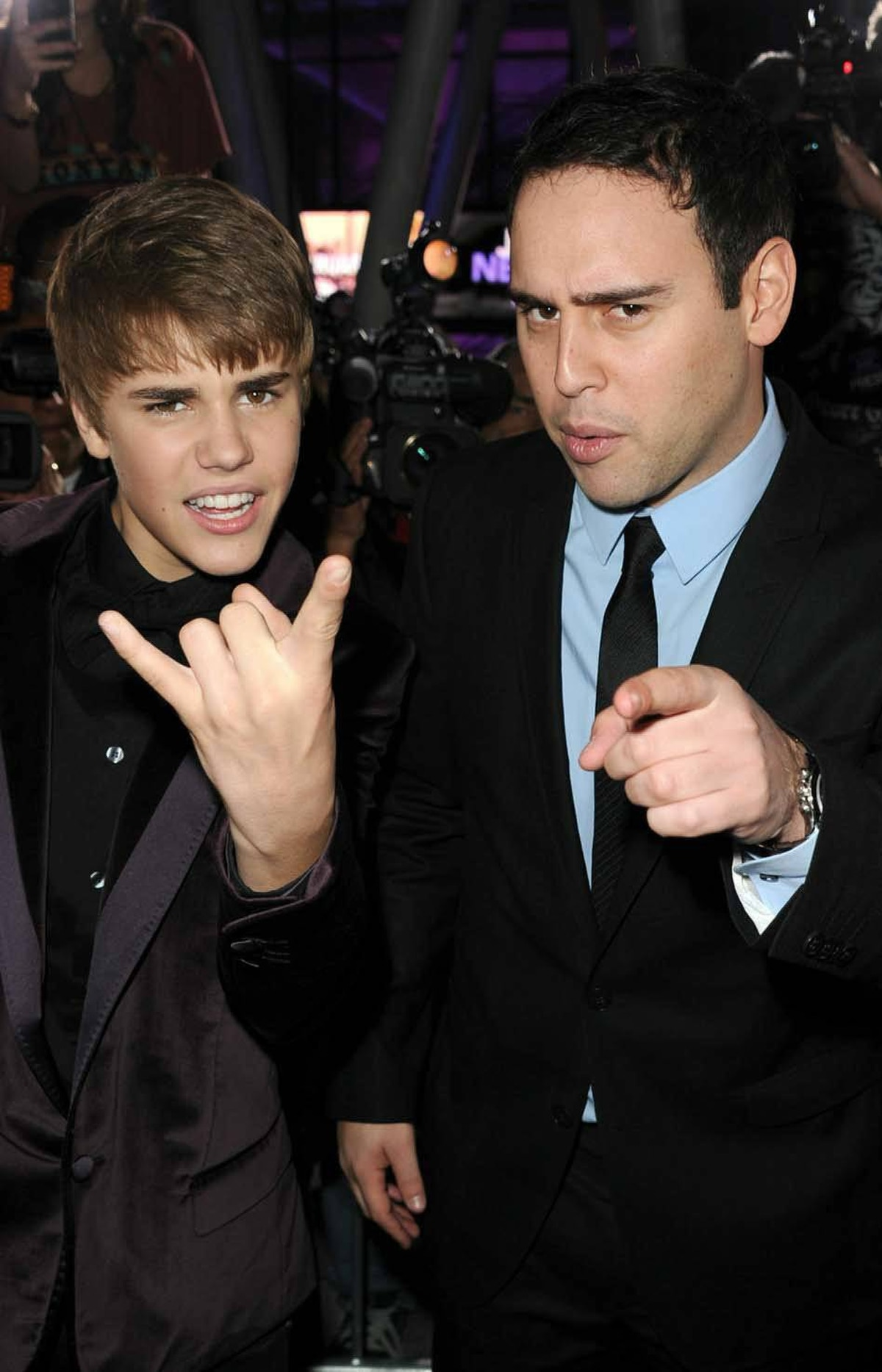 "Justin Bieber and his manager Scooter Braun keep the fans in line at the premiere of ""Justin Bieber: Never Say Never"" in Los Angeles on Feb. 8."