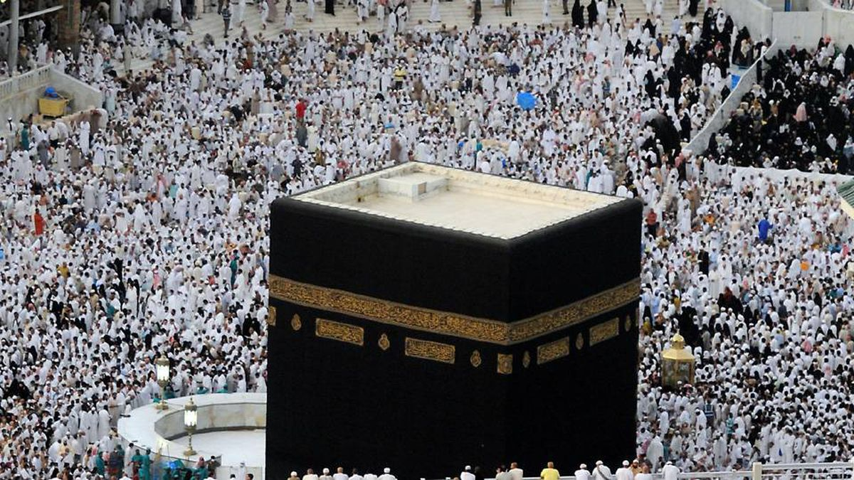 "Muslim worshippers pray around the ""Kaaba"" at the Grand Mosque in the Saudi holy city of Mecca for the sunset prayers before breaking their day-long fast on September 11, 2009."