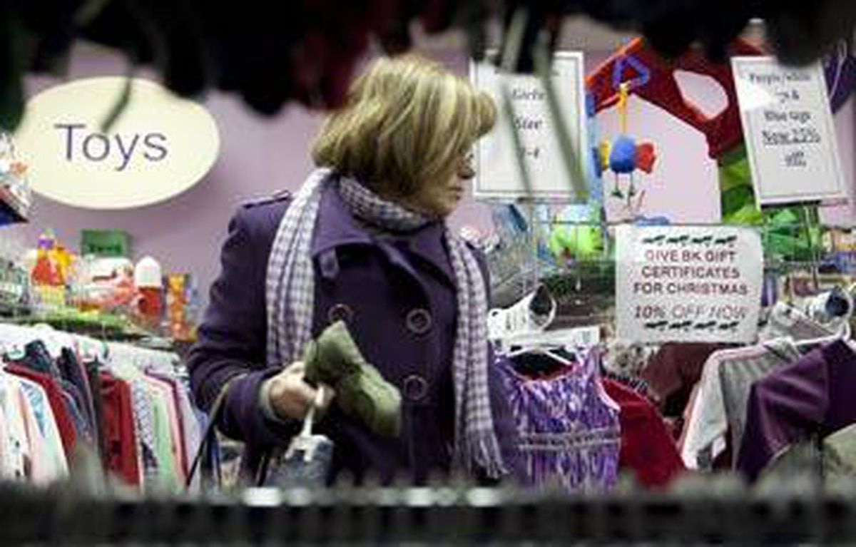Carole Barry inspects the used offerings at Boomerang Kids in Ottawa.