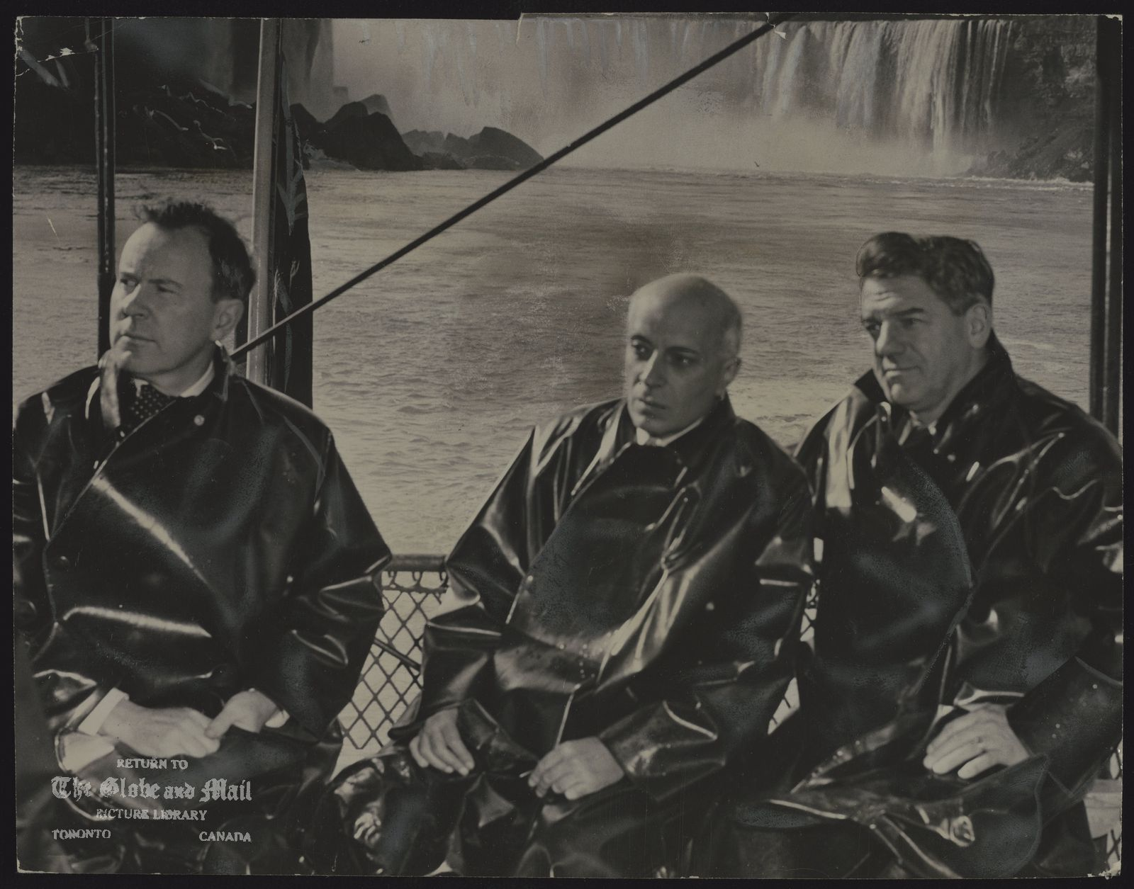The notes transcribed from the back of this photograph are as follows: External Affairs Minister Lester Pearson, Pandit Nehru, and Hydro Commission Chairman Robert Saunders. They talked aboard the Maid of the Mist with the falls roaring behind them.