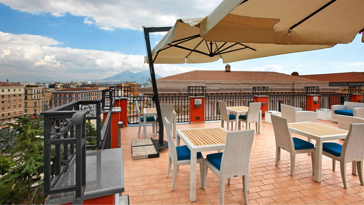 From the rooftop, you can glimpse Teatro di San Carlo, the city's opera house, and the peak of Mount Vesuvius in the distance.