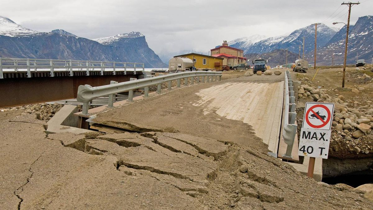 A bridge on Baffin Island shows damage after being slammed by torrential rains and winds, triggering an overflow of the nearby Duval River. Among the emergency measures later required was the dumping of raw sewage into a pristine fjord. CLAUS VOGEL