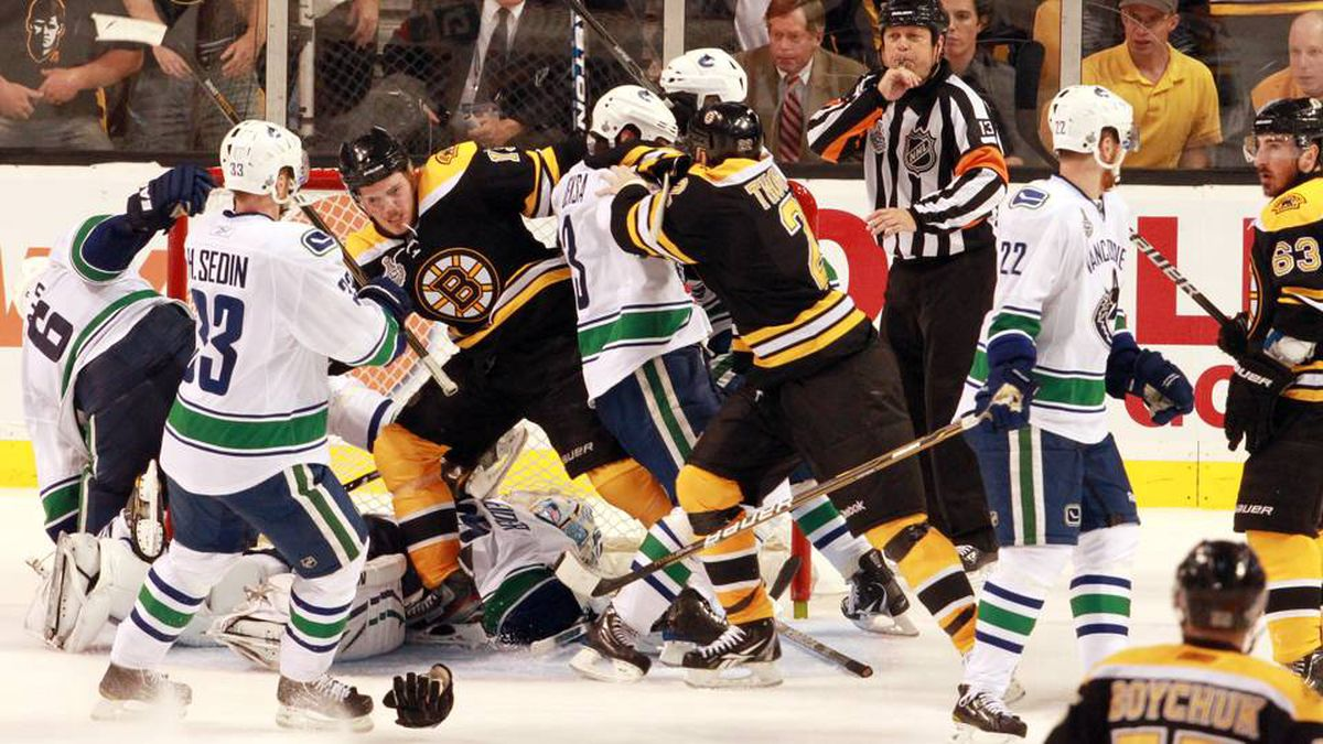 A melee in front of and above Vancouver Canucks goalie Cory Schneider during the third period.