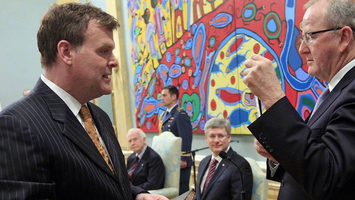 John Baird is sworn-in as Minister of Foreign Affairs as Prime Minister Stephen Harper and Governor-General David Johnston look on at Rideau Hall on May 18, 2011.