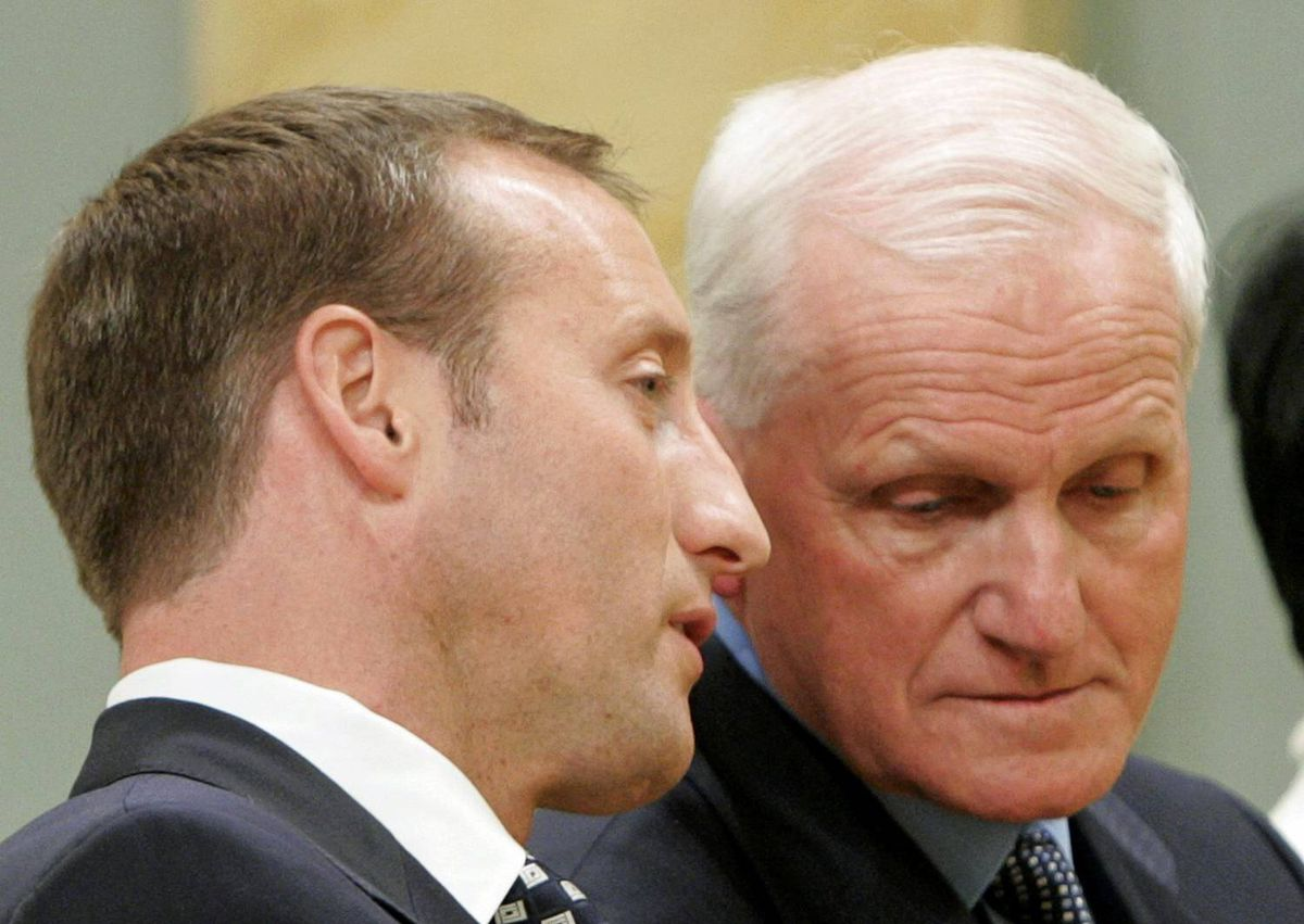 Peter MacKay speaks with Gordon O'Connor during a cabinet swearing-in ceremony at Rideau Hall in Ottawa, August 14, 2007. Mr. MacKay replaced Mr. O'Connor as Defence Minister.