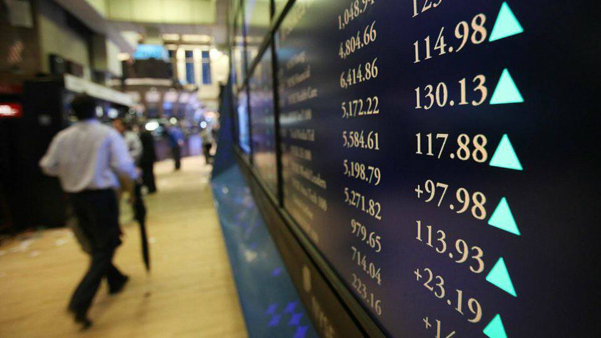 Traders work on the floor of the New York Stock Exchange minutes after the closing bell in October, 2010.