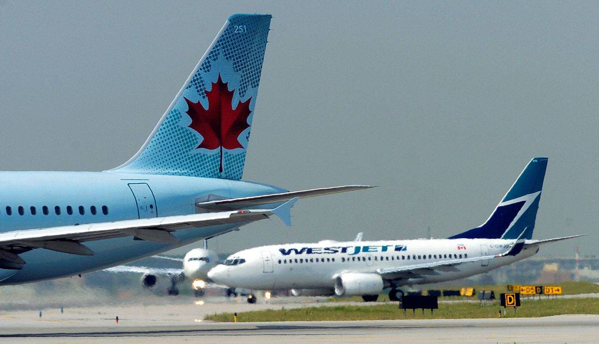 An Air Canada jet is seen on a runway.