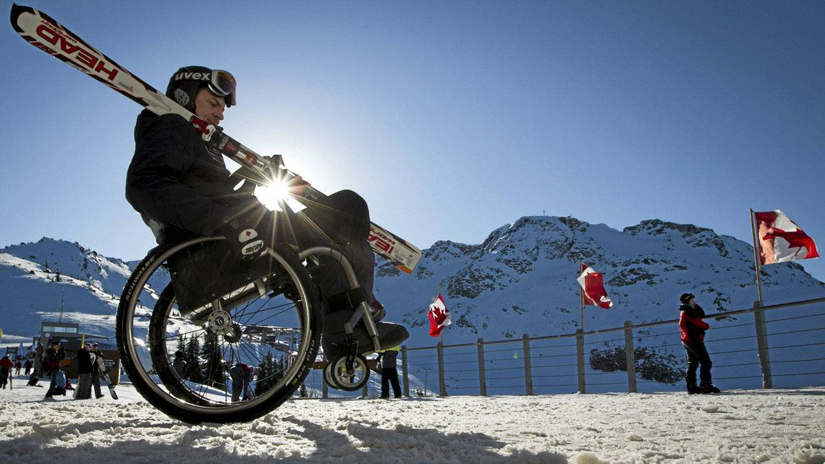 Paralympic skier Brad Lennae gets ready to coach Chelaine McInroy at Whistler, B.C., on Dec. 9, 2011.