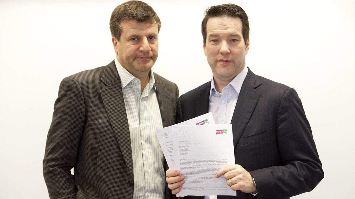 Mobilicity chairman John Bitove, left, is shown with Dave Dobbin, who is leaving his post as chief executive officer of the wireless company.