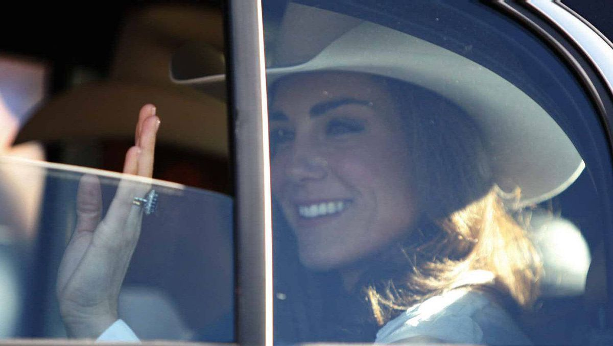 The Duchess of Cambridge waves from her car during the Calgary Stampede parade on Friday July 8, 2011.