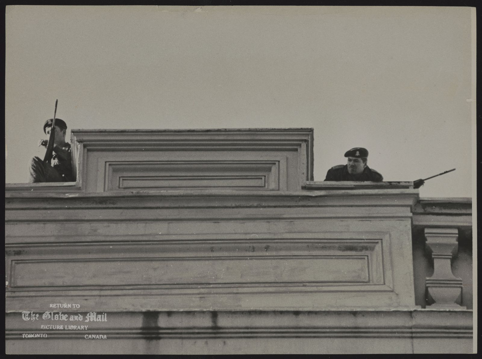 Pierre LAPORTE Montreal; Politician, soldiers on roof at courthouse where Laporte's body has been lying in state.