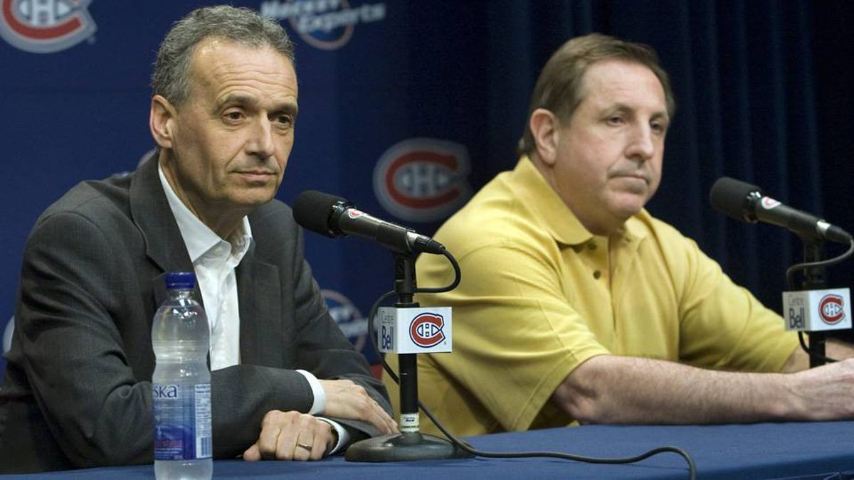 Montreal Canadiens head coach Jacques Martin, right, and general manager Pierre Gauthier speak to reporters.