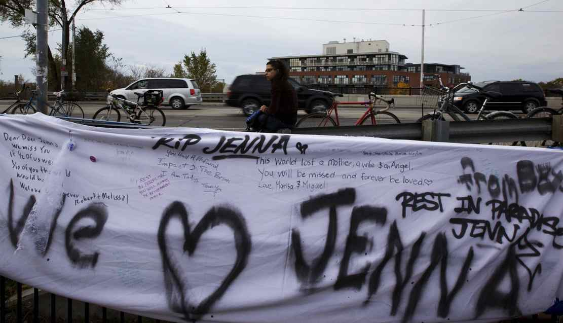 Felicia sits behind a banner at a memorial on Monday, November 14, for pregnant cyclist Jenna Morrison, who was recently killed after being struck by a truck at Sterling and Dundas in Toronto.