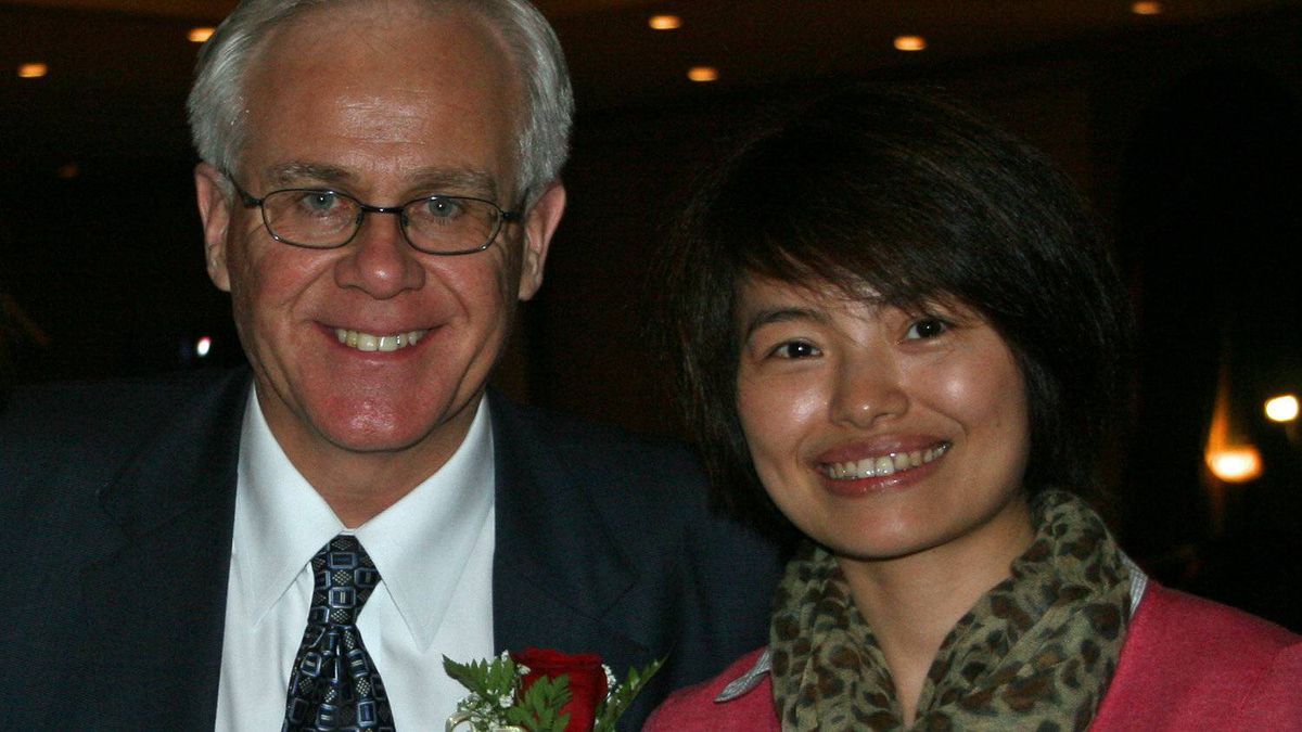 An undated photo showing Tory MP Bob Dechert and Shi Rong, a correspondent with China's state-run news agency, was circulated by email on Sept. 8, 2011.