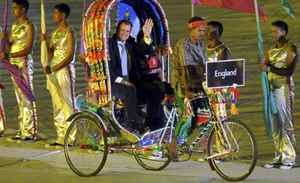 England's captain Andrew Strauss arrives on a rickshaw at the opening ceremony of the International Cricket Council (ICC) Cricket World Cup at the Bangabandhu National Stadium in Dhaka February 17, 2011.