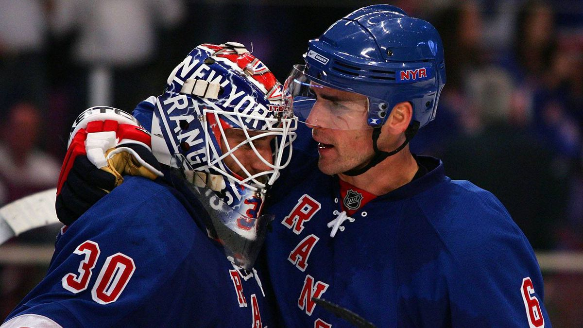 Wade Redden, right, seen during a Rangers game this season, has a contract that has many observers wondering what Glen Sather was thinking when he signed the free-agent defenceman last summer.