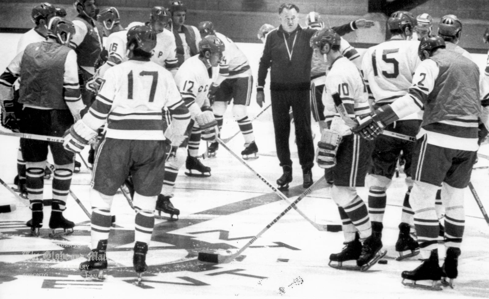 AUGUST 31, 1972 -- MONTREAL -- RUSSIAN NATIONALS PRACTICE -- Boris Kulagin, second coach of the USSR national hockey team, instructs his players during a Thursday, August 31, 1972, practice session held at St. Laurent Arena in a suburb of Montreal. The Russians are practicing for Saturday night's game which is the first of the Canada-Russia summit series. CP PHOTO Originally published Sept. 1, 1972, page A36