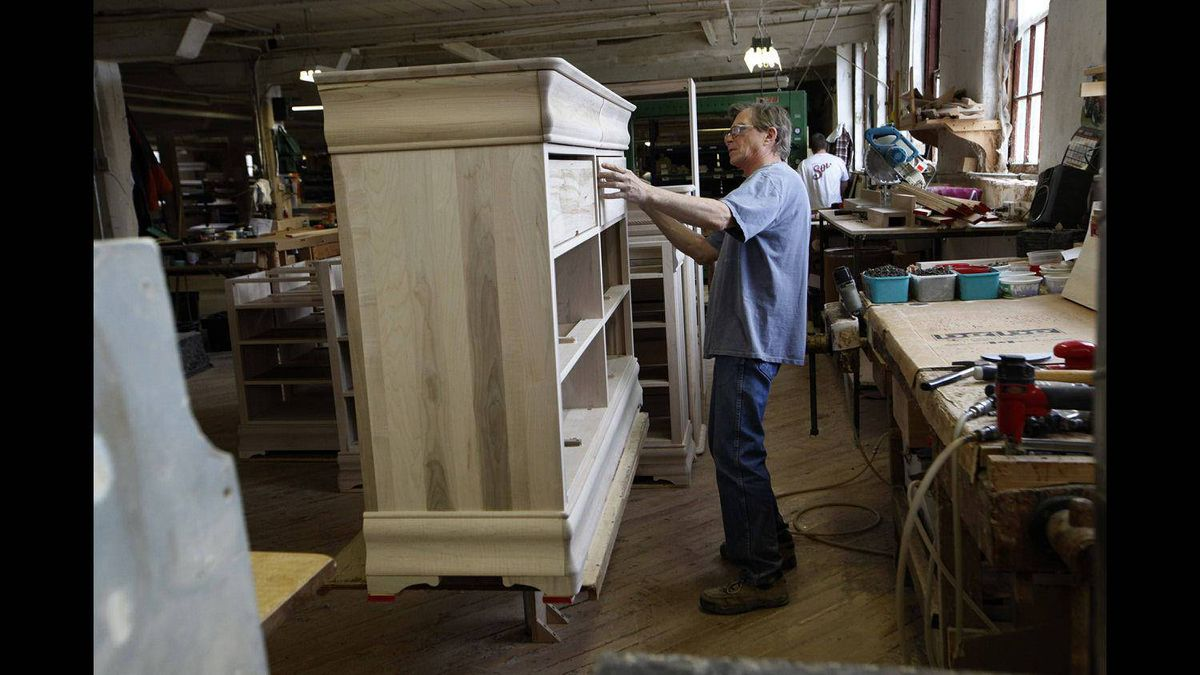 BG Furniture employee Kevin Breutigam helps build a dresser at the Walkerton, Ont., factory.