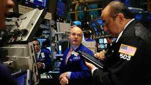 Financial professionals on the floor of the New York Stock Exchange Wednesday