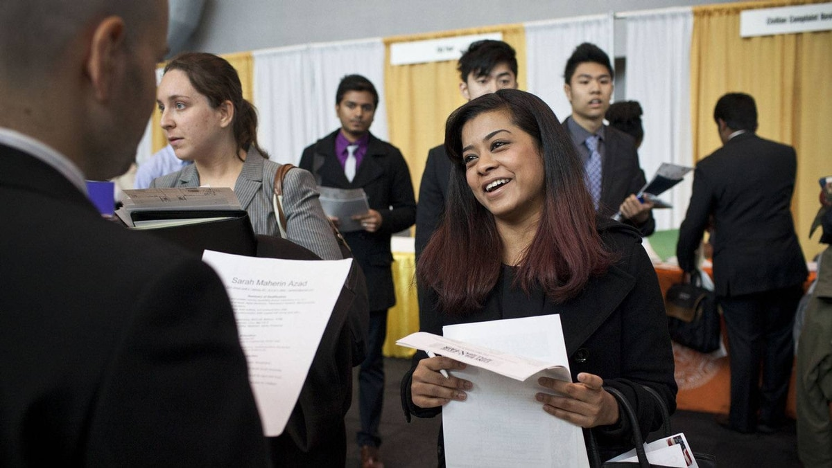 Sarah Azad, a senior majoring in telecommunications at New York City College of Technology, meets with a spokesperson for Hatstand Consulting at the 2012 Big Apple Job and Internship Fair at the Javits Center in New York, April 27, 2012.