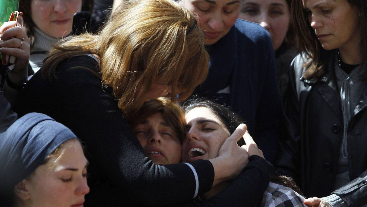 The mother of seven-year-old Miriam Monsonego (bottom R) mourns during the joint funeral service in Jerusalem for her daughter and the other three victims of Monday's shooting in Toulouse March 21, 2012.