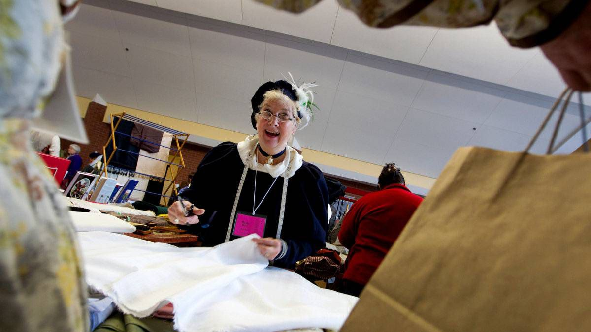 Barb Monk, of Dixon's Dry Goods in Odessa, Ont., cuts fabric for a customer. She and her husband, John Dixon, specialize in historically correct fabrics from several eras.