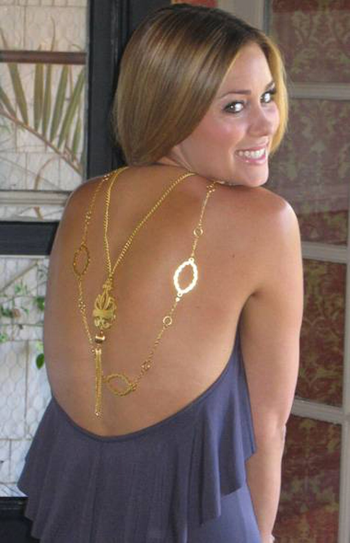 TV personality Lauren Conrad displays her Foxy Originals necklace.