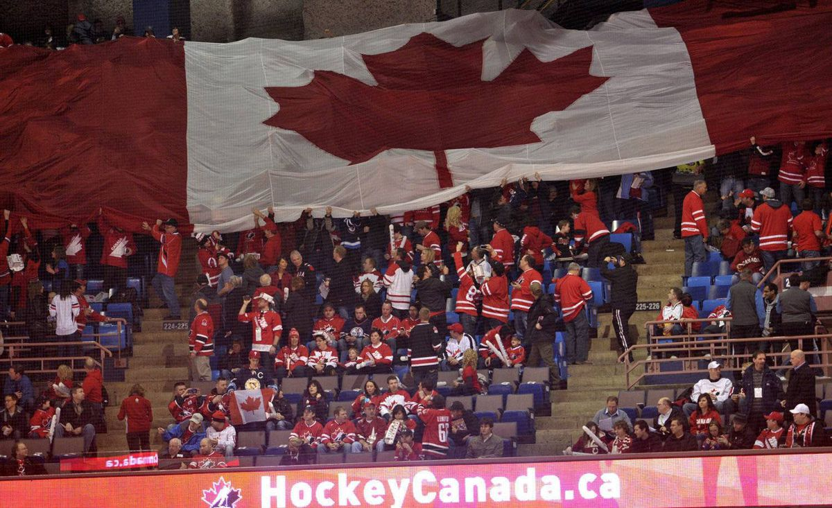 A large Canadian flag is passed around by fans prior to the Canada playing Denmark at the IIHF World Junior Championships hockey action in Edmonton on Thursday, Dec. 29, 2011.