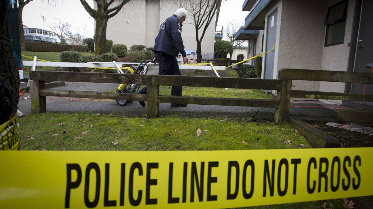 A member of the forensic identification team of the Vancouver Police Department makes his way into a home in March 2011.