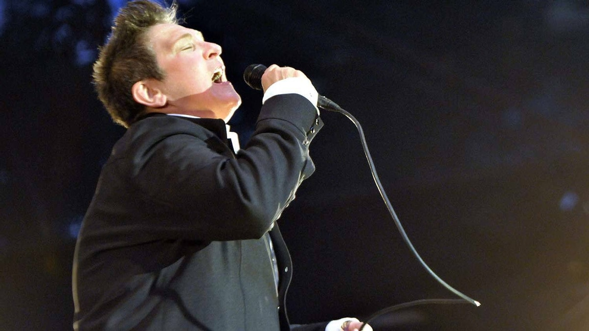 k.d Lang performs on an open-air stage as part of the Luminato festival in downtown Toronto on Friday, June 17,