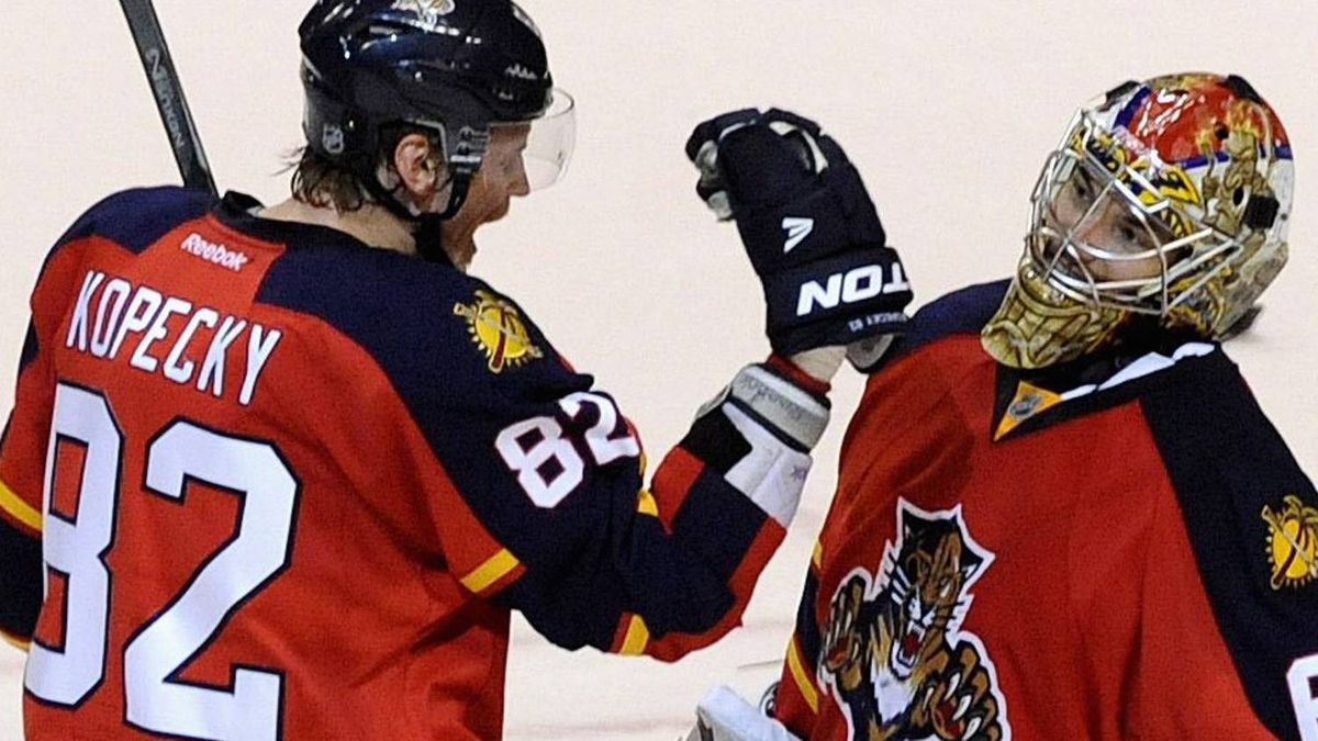 Florida Panthers' Tomas Kopecky (L) congratulates goalie Jose Theodore (R) on his shutout against the New Jersey Devils following their NHL Eastern conference quarterfinal playoff hockey Game 5 in Sunrise, Florida April 21, 2012. REUTERS/Rhona Wise