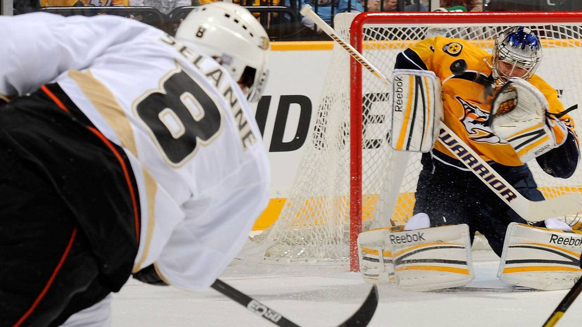 Teemu Selanne #8 of the Anaheim Ducks takes a shot on goalie Pekka Rinne #35 of the Nashville Predators at the Bridgestone Arena on October 29, 2011 in Nashville, Tennessee. (Photo by Frederick Breedon/Getty Images)