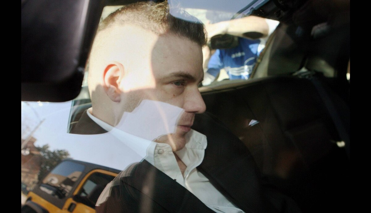 Michael Rafferty is transported from the courthouse in the back of police cruiser in London, Ontario, Wednesday, March, 14, 2012.