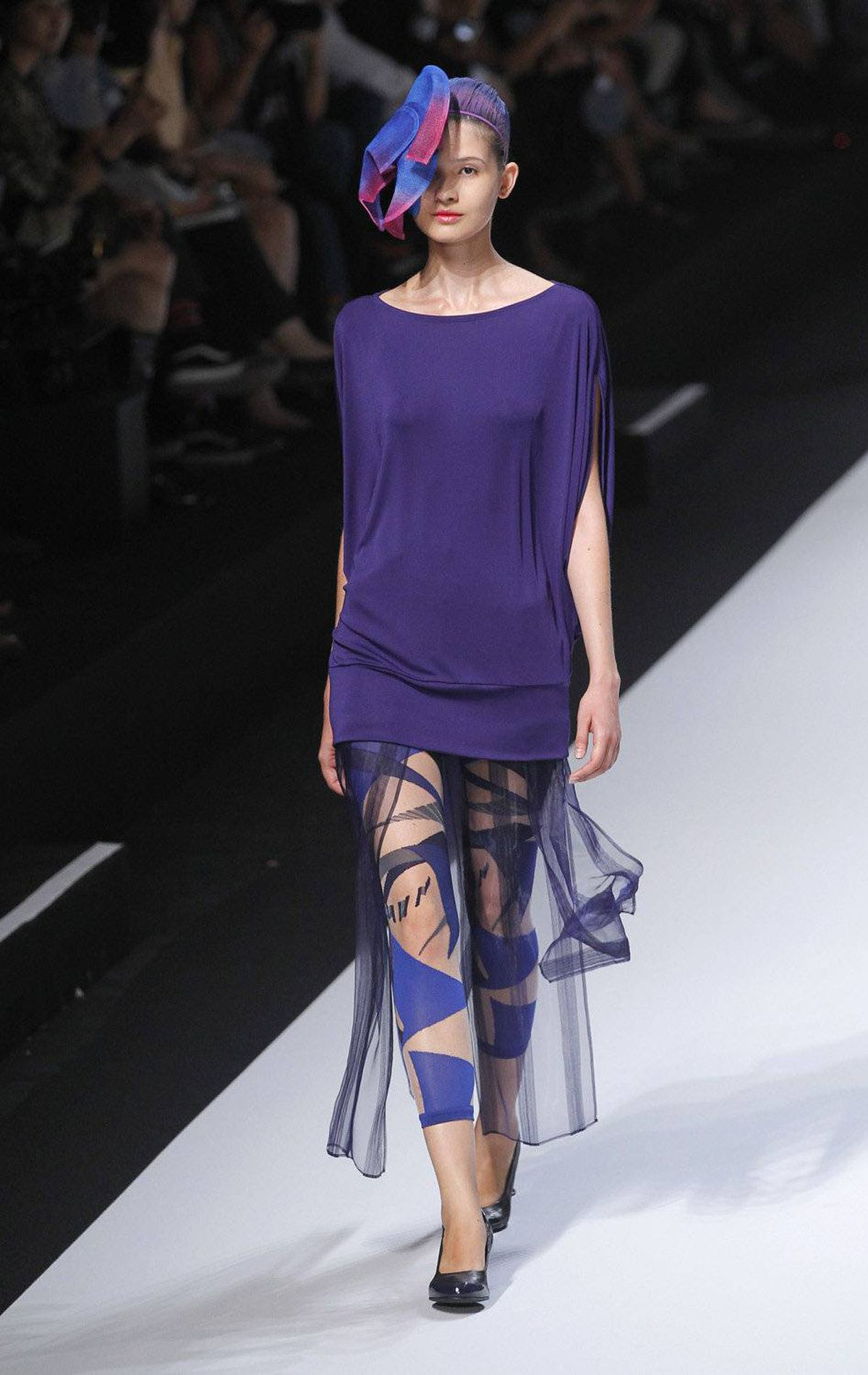 A model presents a creation by Japanese designer Yoshiyuki Miyamar for Issey Miyake during the spring/summer 2012 ready-to-wear collection show, on October 2, 2011 in Paris.