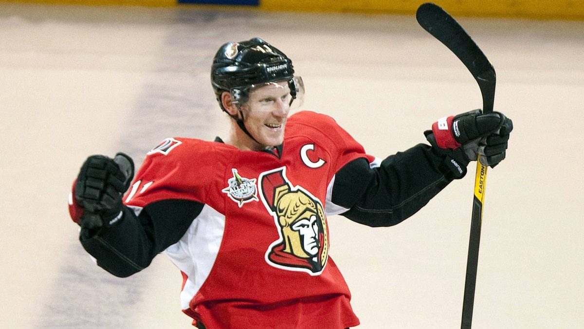 Ottawa Senators' Daniel Alfredsson celebrates after scoring the game winning goal in a shootout against the Minnesota Wild during NHL action in Ottawa Tuesday October 11, 2011.