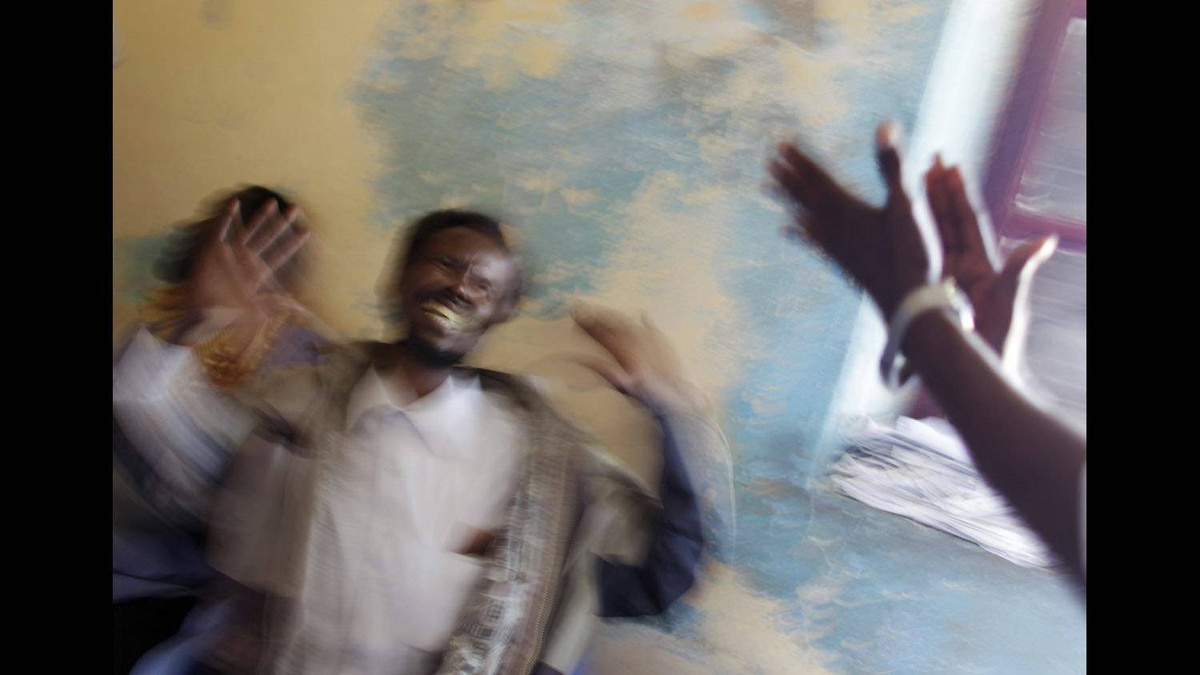 NPAC Pictures of The Year, Honorable Mention Picture Story - A new patient becomes excited during his initial assessment as staff try to calm him down in the Habeb Public Mental Hospital run by Dr. Abdurrahman Ali, known as Dr. Habeb, his nickname, in Mogadishu, Somalia on Sept. 8, 2011.