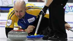 Alberta skip Kevin Koe makes a shot during a morning draw against Newfoundland and Labrador at the Tim Hortons Brier in Saskatoon, March, 6, 2012.