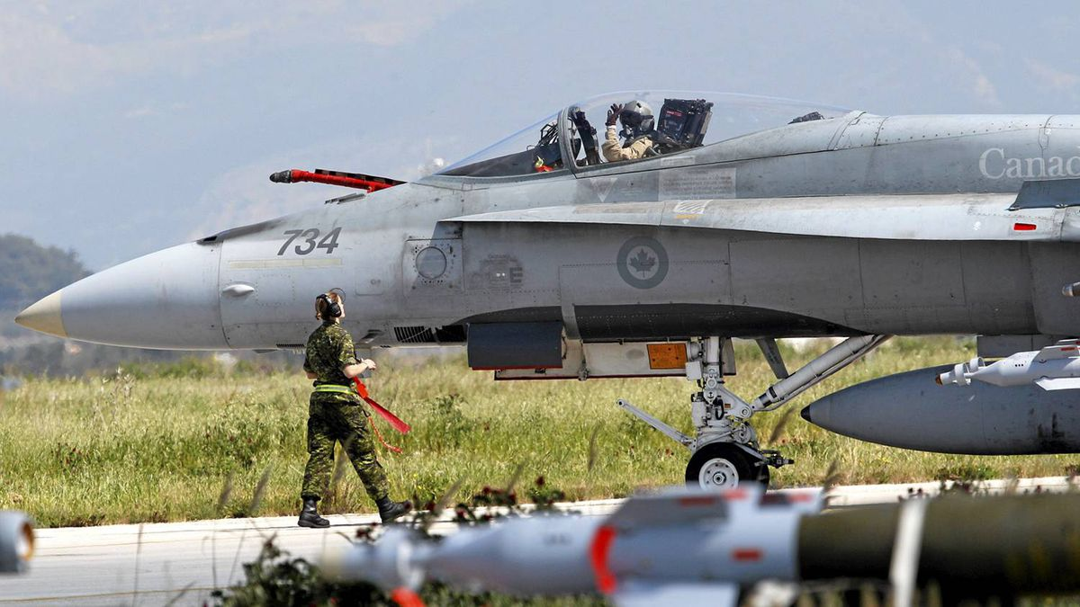 A Canadian Forces CF-18 Hornet fighter jet taxis at the Birgi NATO Airbase in Trapani, Sicily, March 24, 2011