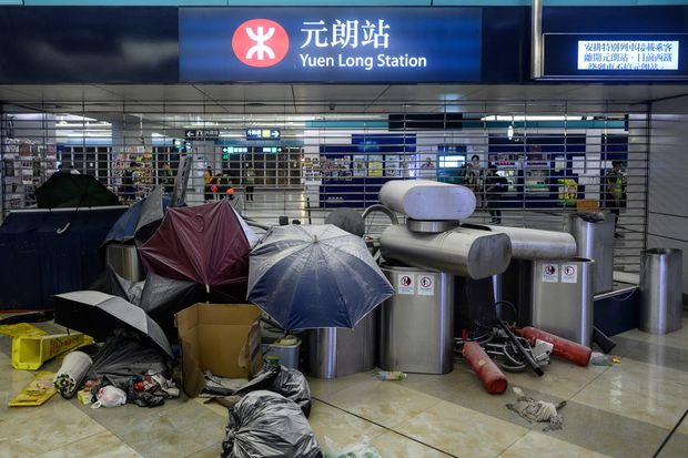 Hong Kong protesters denounce police inaction six months after mob attack