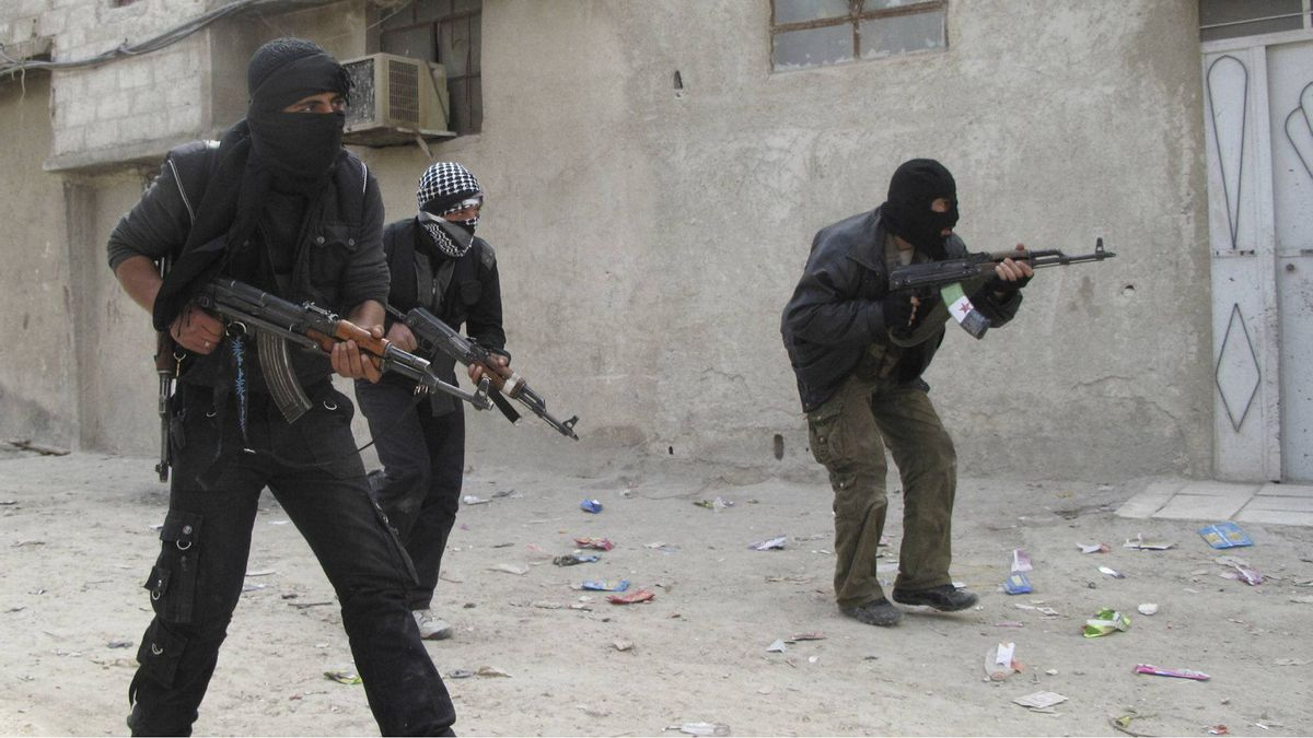 In this Sunday, April 1, 2012 photo, Free Syrian Army fighters train in a neighborhood of Damascus, Syria.