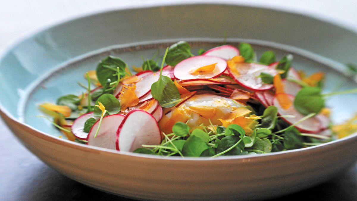 Radish salad with bottarga and poached egg from the cookbook Eat with Your Hands by Zakary Pelaccio.