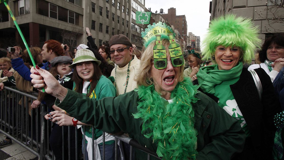 Green-clad spectators watch the St. Patrick's Day parade in New York on Saturday.
