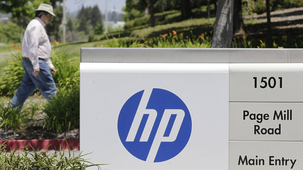 The main entrance of Hewlett-Packard headquarters in Palo Alto, Calif. HP is the world's largest PC and printer firm and one of the biggest players in servers, computer storage equipment, networking gear and tech services. But for much of the last decade, it has floundered, led in conflicting directions by four different CEOs.
